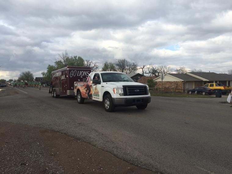 Wide shot of ACES truck in parade