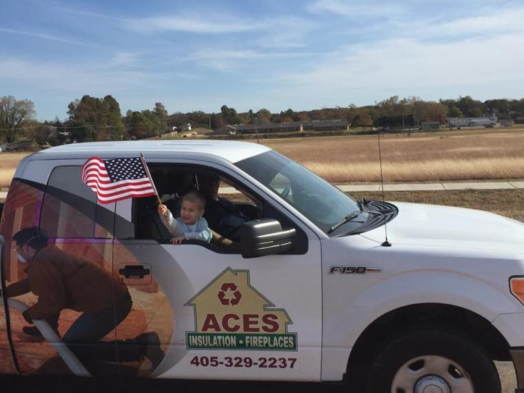 Toddler in ACES truck with U S Flag